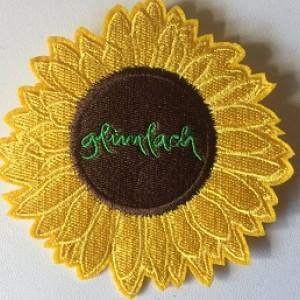 NIEUW in de webshop: Een zonnebloem met een glimlach